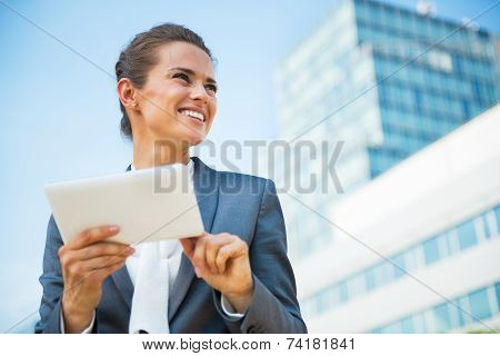 Happy Business Woman Using Tablet Pc In Front Of Office Building