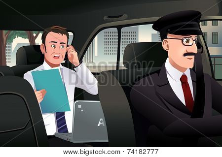 Businessman Talking On The Phone In A Car