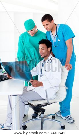 Serious Male Doctors Looking At X-ray