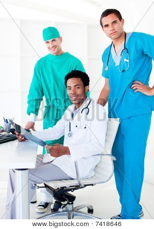 Assertive Male Doctors Looking At X-ray