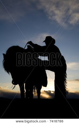Man Getting On Horse