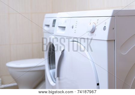Drying Machine, Laundry Washer  And Lavatory Bowl In The Bathroo