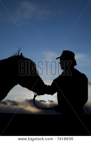 Man Touching Horses Head