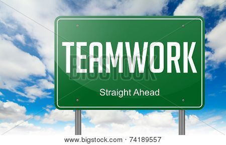 Teamwork on Green Highway Signpost.