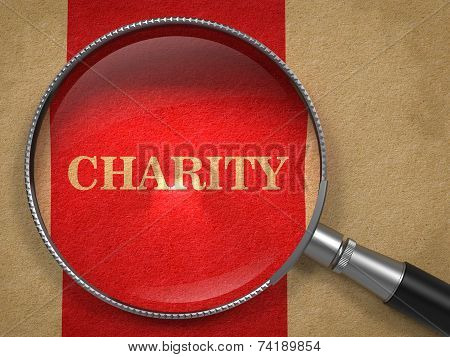 Charity through Magnifying Glass on Old Paper.