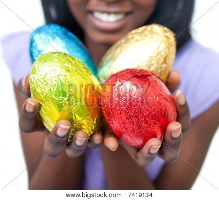 Close-up Of A Woman Showing Colorful Easter Eggs