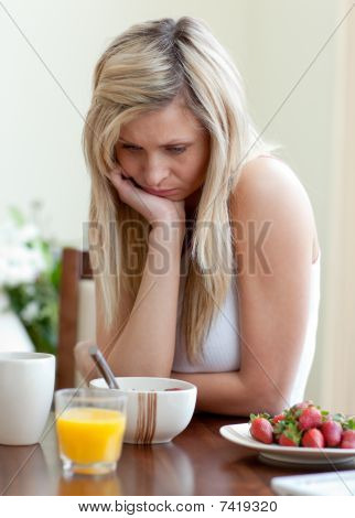 Tired Woman Having An Healthy Breakfast