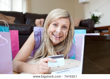 Laughing Woman Shopping Online Lying On The Floor