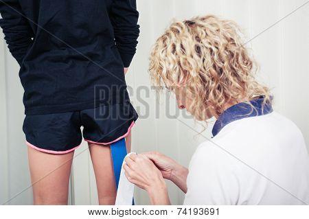 Physiotherapist Applying Kinesio Tape