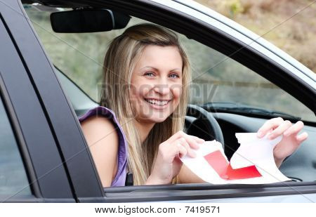 Jolly Young Female Driver Tearing Up Her L Sign