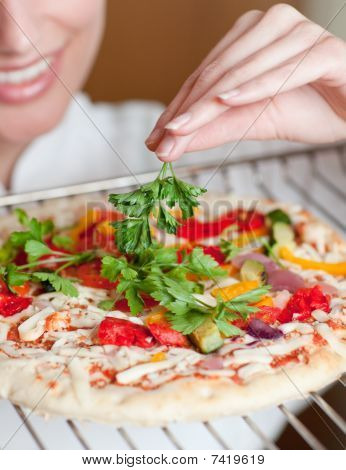 Close-up Of A Female Chef Preparing A Pizza