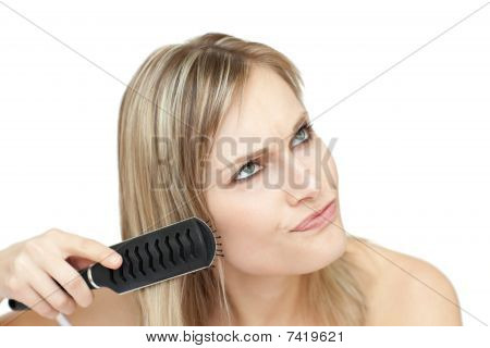 Annoyed Woman Bruishing Her Hair