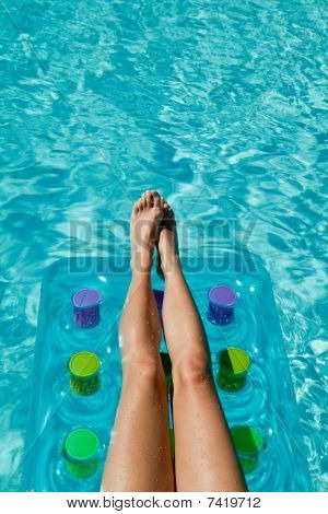 Woman Relaxing In Waterpool - Legs On The Mattress
