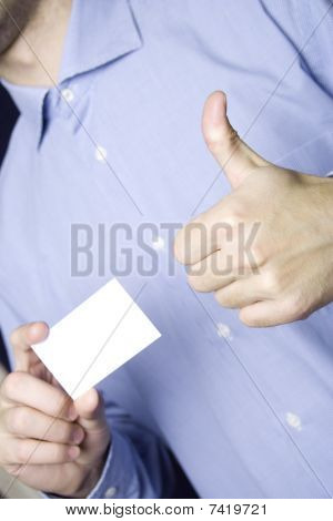 Business man holding blank card. OK