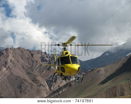 Yellow Rescue Helicopter In The Mountains