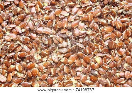 Top View Of Broken Flax Seeds . Can Be Used As Background