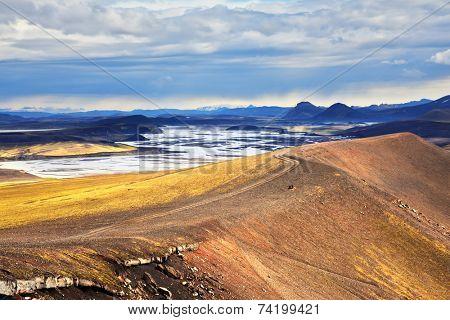 National park Landmannaleygar in July. Comb orange rhyolite mountains dashed off tourist jeeps