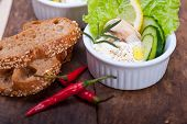 picture of dipping  - fresh organic garlic cheese dip salad on a rustic table with bread - JPG