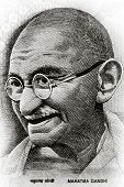 stock photo of lithographic  - Close up shot of Gandhi on rupee note - JPG