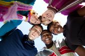 stock photo of ethnic group  - A group of smiling faces of multi - JPG