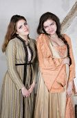 pic of wench  - two brunette young girls dressed as princess - JPG