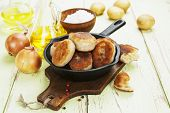 stock photo of patty-cake  - Patties with potatoes in a cast iron frying pan - JPG