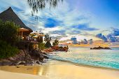 stock photo of tropical food  - Cafe on tropical beach at sunset  - JPG
