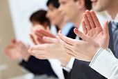 stock photo of applause  - Photo of business partners hands applauding at meeting - JPG
