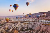 picture of air transport  - Hot air balloon flying over rock landscape at Cappadocia Turkey - JPG