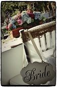 foto of centerpiece  - Chiffon wrapped chiavari wedding chair with bride sign - JPG