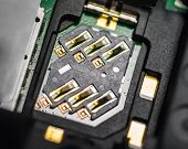 picture of micro-sim  - Macro shot of SIM card slot from the back of black cell phone - JPG