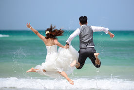 stock photo of married  - happy just married young couple celebrating and have fun at beautiful beach - JPG