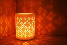 stock photo of luminaria  - Lantern casts shadows on wall - JPG