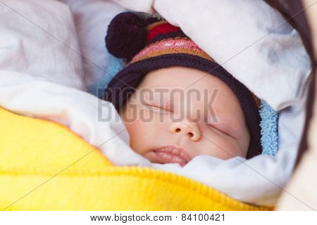 cute little baby sleeping in carriage