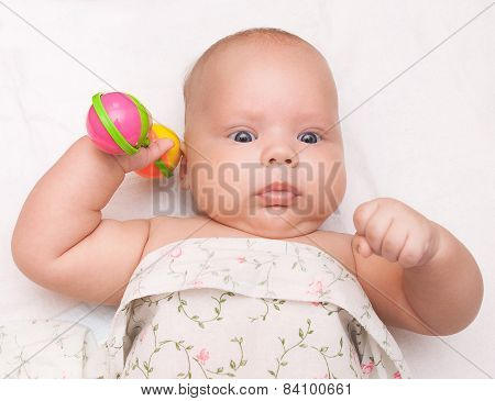 baby boy playing with rattle