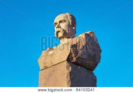 Taras Shevchenko Monument In Energodar On Blue Sky Background