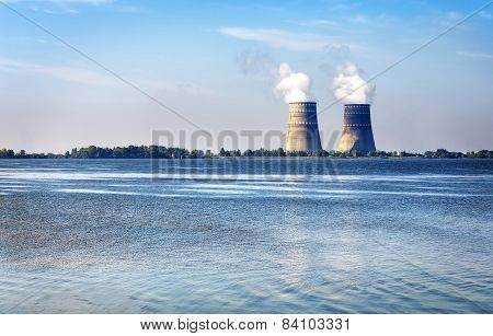 Cooling Towers With Steam From A Nuclear Power Station On A River