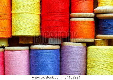 Coils with color threads. Industrial background.