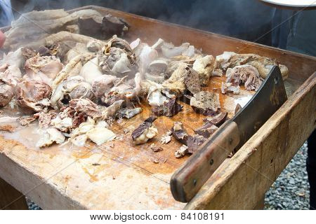 Chopped cooked heart lungs liver kidneys on rustic table