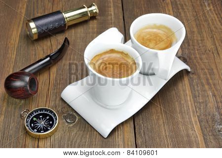 Spyglass, Compass, Smoking Pipe And Two White Espresso Coffee Cups