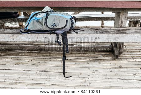 Camera Bag On Wooden Bench