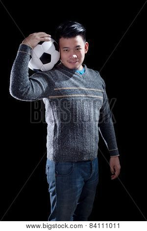 Young Man Holding Soccer Football With Smiling Face Standing Against Black Background Use For People