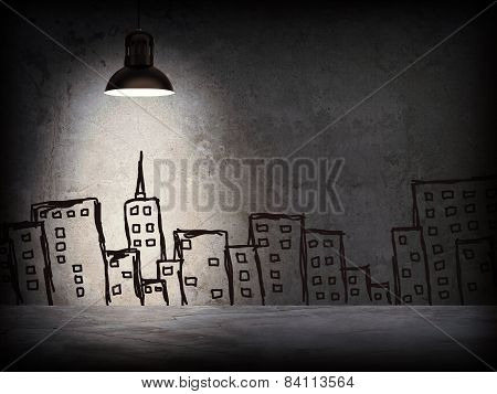 Concrete wall with sketches of buildings. Left standing lampshade