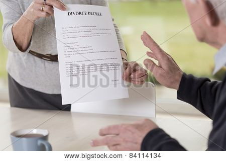 Female Hands Holding Divorce Paper