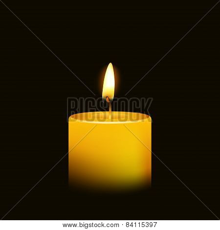 One candle flame at night closeup - isolated.