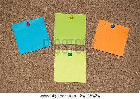 Multi Coloured Post it Notes on a Cork Board