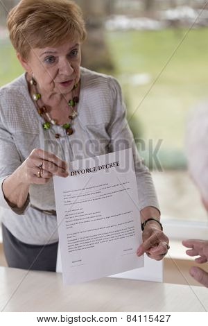 Woman Giving Husband Divorce Paper