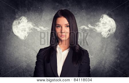 Sad woman with steam from ears. Concrete gray as backdrop