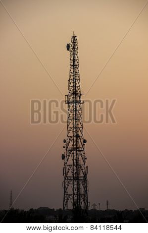 Communication tower captured on a clear sky nearing dusk