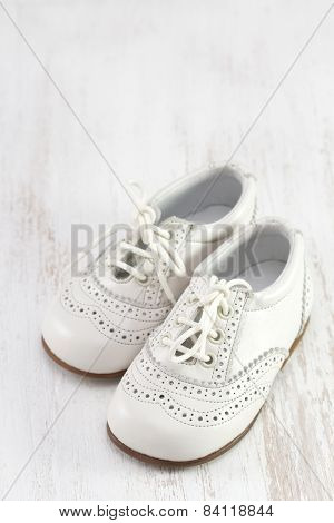 White Baby Shoes On White Background